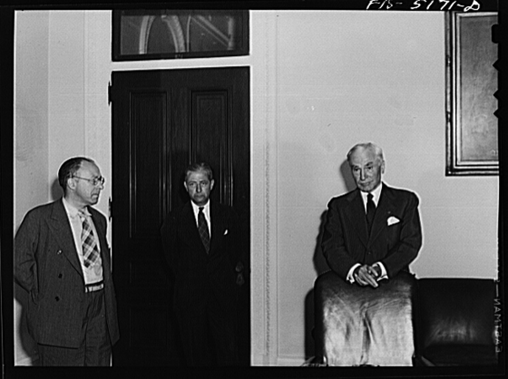 Washington, D.C. Mr. Este (left), a Swedish journalist on tour in the United States, attending Secretary Hull's press conference