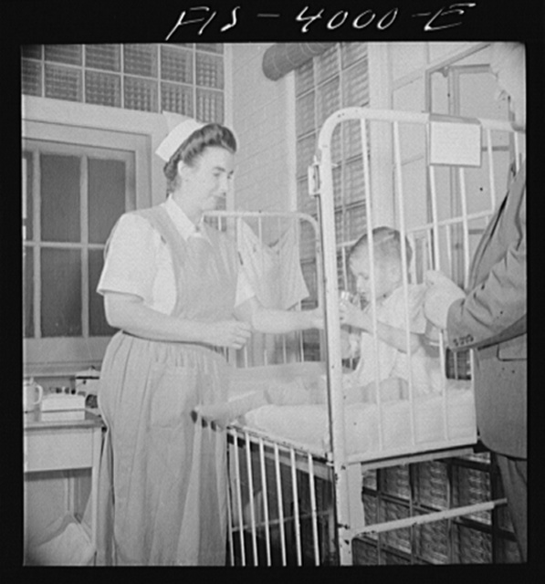 Washington, D.C. Mr. Lund, who is head of the District Red Cross, visits the Children's Hospital where General MacArthur's niece is a nurse's aid