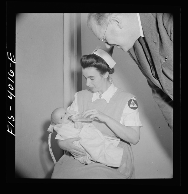 Washington, D.C. Mr. Lund, who is the head of District Red Cross, visits Children's Hospital, where General MacArthur's niece is a nurse's aid