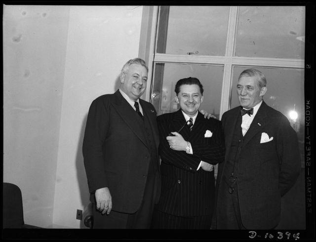 Washington, D.C. Opera singer Lauritz Melchior (left), and Gene (i.e., Jean) Hersholt, movie actor (center), visiting William Knudsen, director-general of the Office of Production Management (OPM)