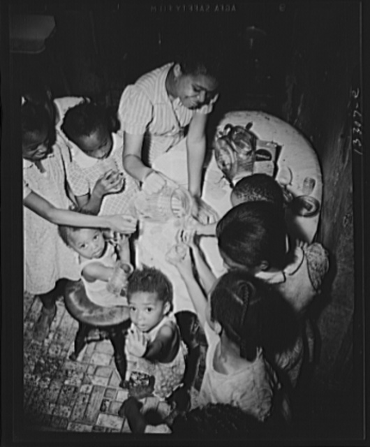 Washington, D.C. Pouring lemonade at a birthday party on Seaton Road