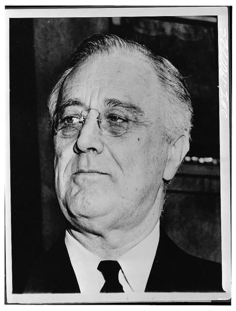 Washington, D.C. President Roosevelt on the steps of St John's Episcopal church after he had attended prayer services marking the ninth anniversary of this first inauguration.