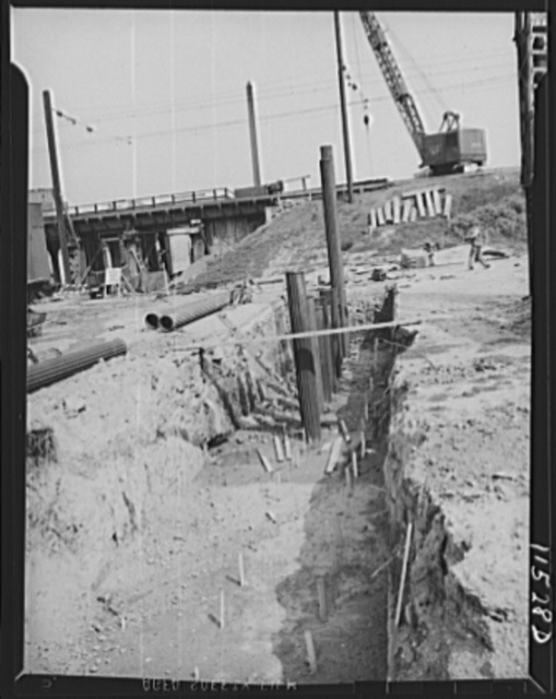 Washington, D.C. Row of piles being driven in a trench. In the foreground are rows of stakes that indicate where other piles are to be driven