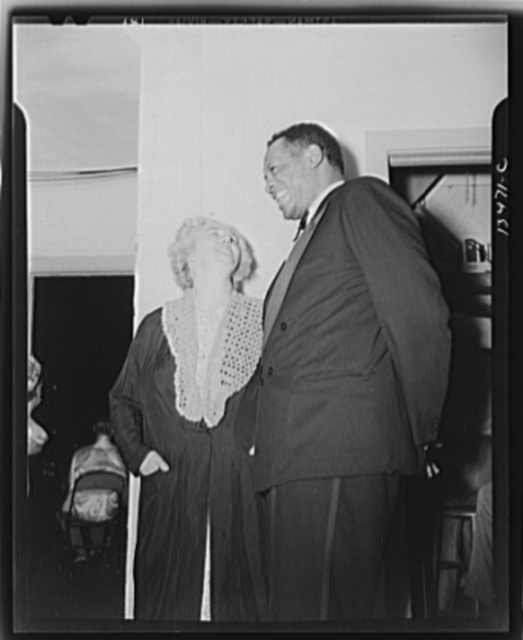 Washington, D.C. Russian war anniversary benefit at the Watergate. Madame Litvinoff, wife of the Russian Ambassador, backstage with Paul Robeson