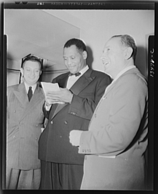 Washington, D.C. Russian war anniversary benefit at the Watergate. Paul Robeson and autograph hunters backstage