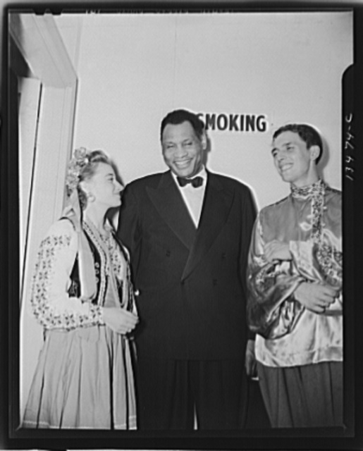 Washington, D.C. Russian war anniversary benefit at the Watergate. Sonia Trembach, singer with the Balalaika Orchestra, and conductor Paul Kovriga chatting with Paul Robeson backstage
