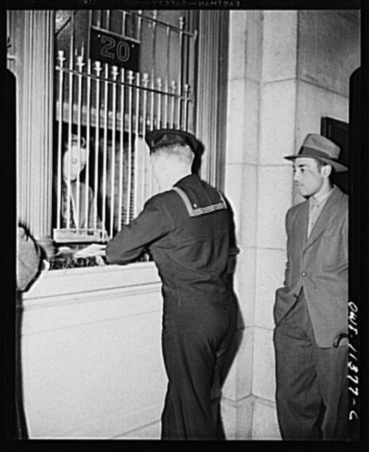 Washington, D.C. Sailor receiving his transportation at the ticket window at the Union Station