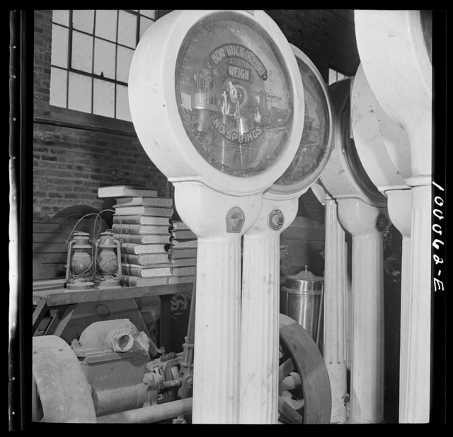 Washington, D.C. Salvage drive, Victory Program. Restaurant scales among objects stored in warehouse of District wholesale junk company