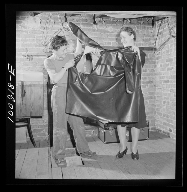 Washington, D.C. Scrap salvage campaign, Victory Program. Torn rubber raincoat found in attic will be used as rubber scrap