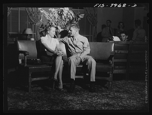 Washington, D.C. Sergeant George Camblair and his girl sitting out a number at a United Service Organization USO) dance while he is at home on a weekend furlough