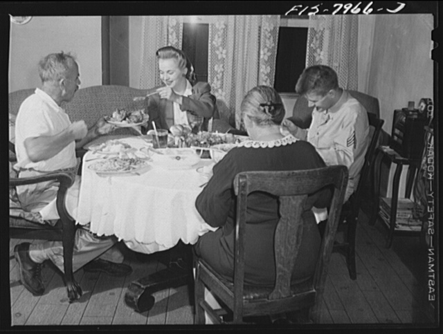 Washington, D.C. Sergeant George Camblair and his girlfriend having dinner with his family while he is at home on a weekend furlough