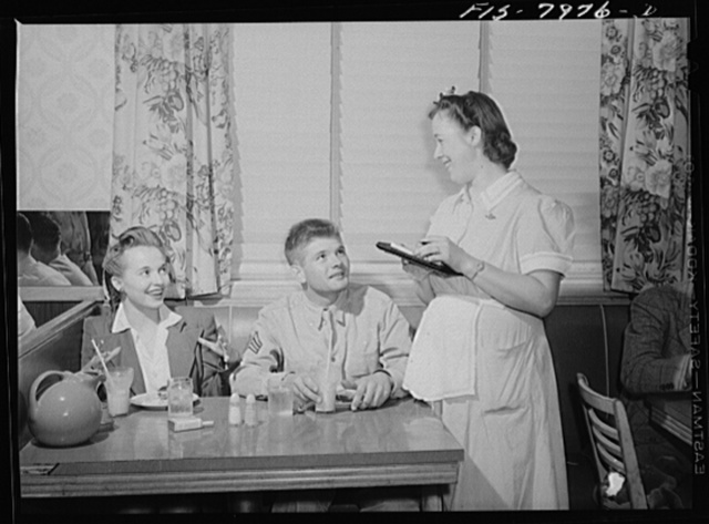 Washington, D.C. Sergeant George Camblair takes his girl to have some refreshments after dancing at the United Service Organization (USO) dance while he is at home on a weekend furlough