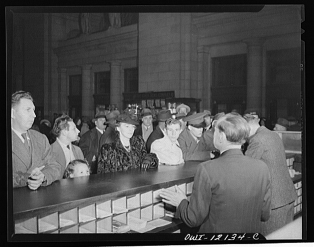 Washington, D.C. Soldiers and civilians purchasing tickets at the Union Station