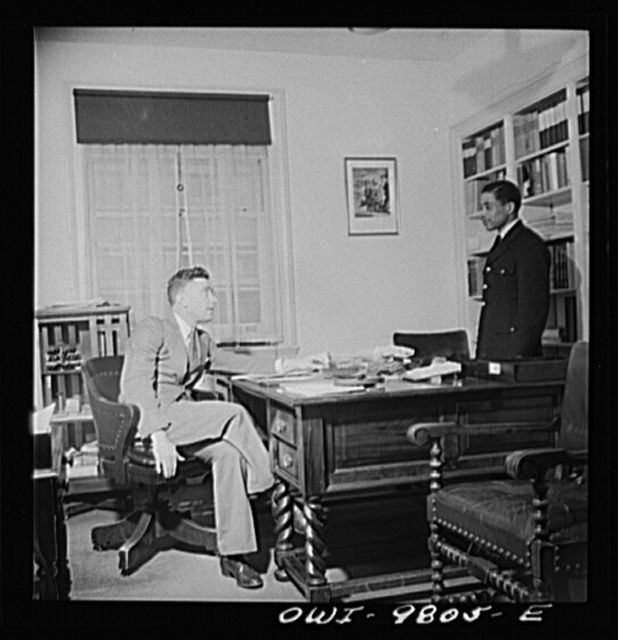 Washington, D.C. South African Legation on Massachusetts Avenue. First secretary of the legation giving orders to a messenger