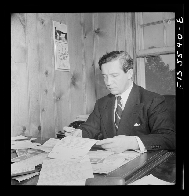 Washington, D.C. The Icelandic legation. Minister Thors studying a report in his chancery office