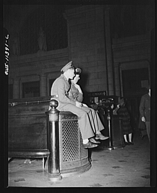 Washington, D.C. Two soldiers await the arrival of a troop train at the Union Station