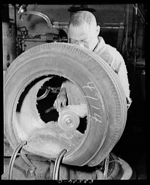 Washington, D.C. Washington tire store. Buffing the lining of a tire before vulcanizing on a patch