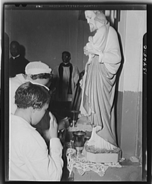 Washington, D.C. Worshippers before the altar in the St. Martin's Spiritual Church