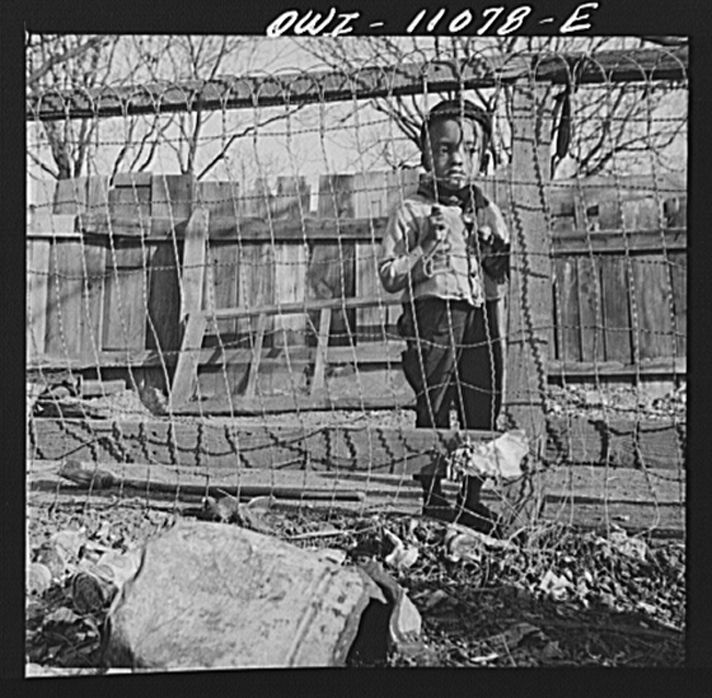Washington (southwest section), D.C. Boy playing in the backyard of his home