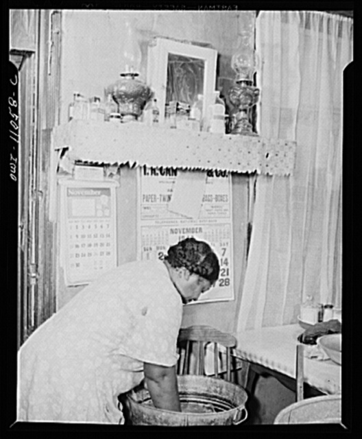 Washington (southwest section), D.C. Negro woman washing clothes in her kitchen