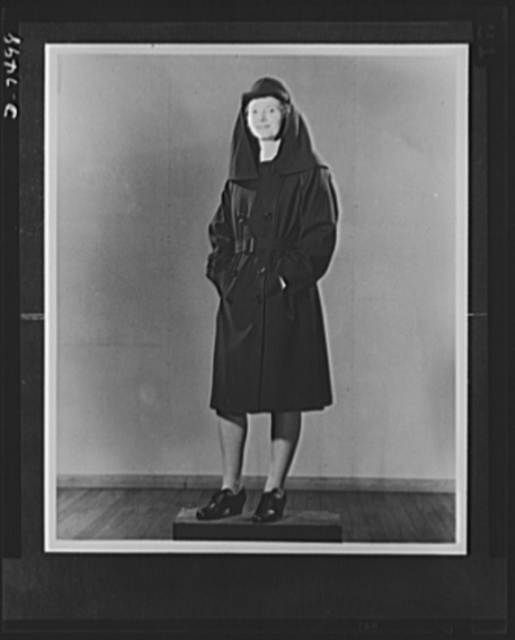 WAVES (Women Accepted for Voluntary Emergency Service). Lieutenant Marion Enright, U.S. Naval Reserve, poses in her raincoat and havelock. The smart hat cover is a havelock.