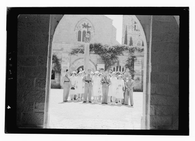 Wedding at St. George's Cathedral on June 3, 1942. Group through archway