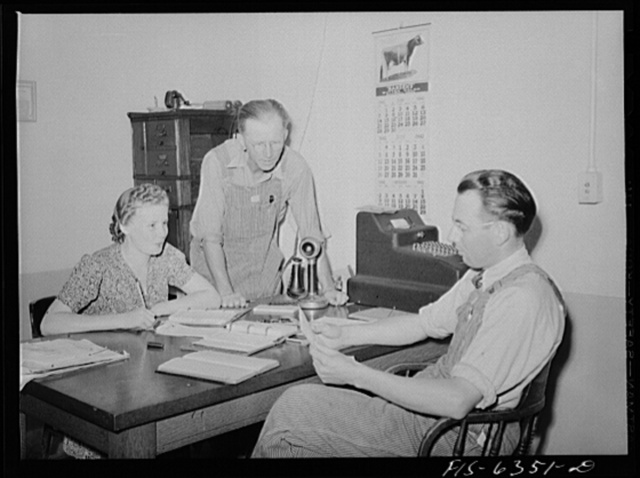 Westby, Vernon County, Wisconsin. Edward Saugstad, president of the cooperative creamery discussing business with the manager and secretary
