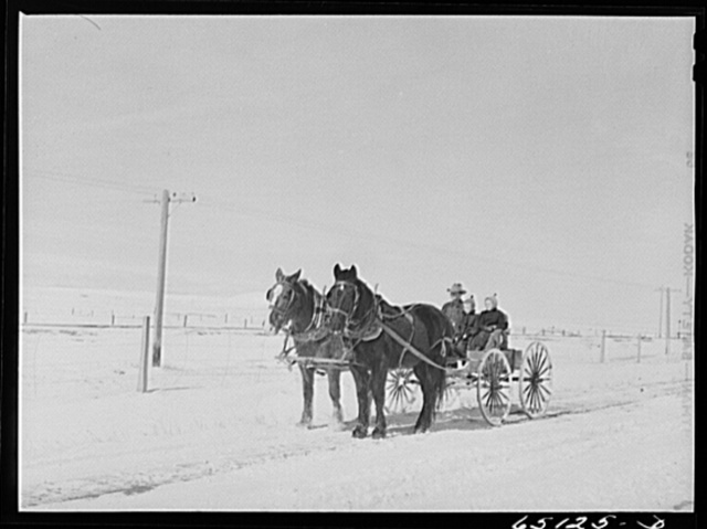 Wheatland County, Montana. Farmer and daughters driving to town