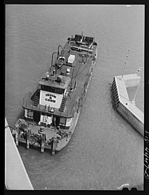 Wheeler Dam, Alabama (Tennessee Valley Authority (TVA)). Tugboat from Paducah, Kentucky in lock at Wheeler Dam, Alabama