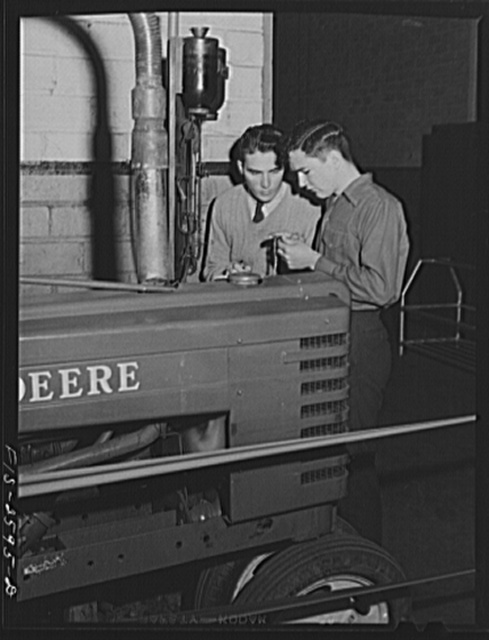 William Shold and Fred Wentworth checking gas consumption of a tractor during a brake test experiment. Iowa State College. Ames, Iowa