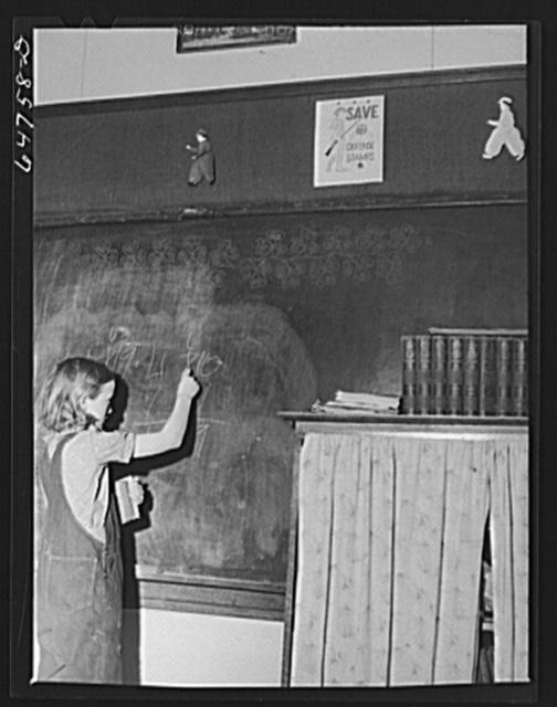Williams County, North Dakota. Child at blackboard in a rural school
