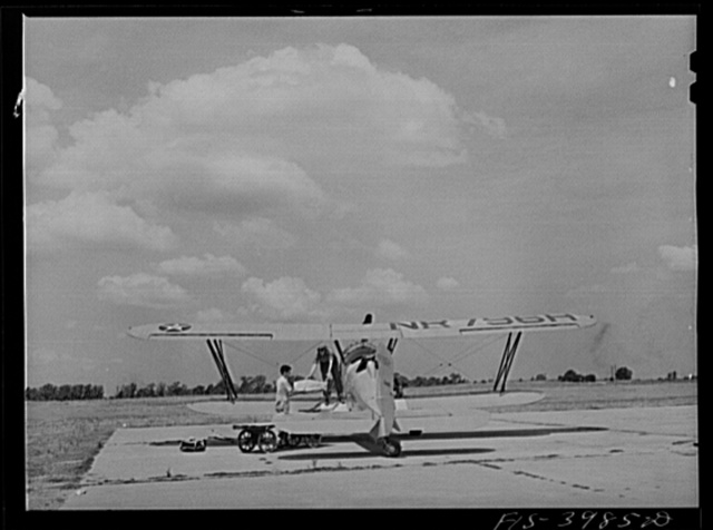 Wilson Dam, Alabama (Tennessee Valley Authority (TVA)). Loading insecticide into plane used in malaria control work