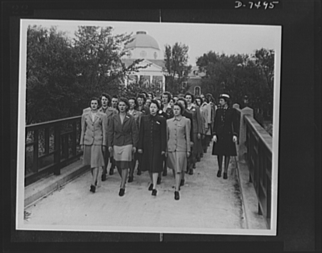 Women Accepted for Voluntary Emergency Service. Hep, two, three, four clipping of a brisk cadence, enlisted WAVES cross their first bridge enroute to their initial drill session on the Smith College Campus, Northampton, Massachusetts. The gals didn't even have time to change from their street clothes before the WAVE ensign on the right started them off for their exercise