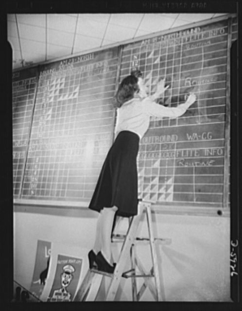 Women aircraft workers. Perched high on a ladder behind the ticket counter at the Washington National Airport, twenty-two-year-old Kay Dowd makes entries on the flight information board. Graduate of an Eastern college, Kay served her airport apprenticeship at New York's La Guardia Airfield. As Supervisor of Reservations at the Washington airport, she's one of the nation's many women who are taking over strategic jobs formerly held by men