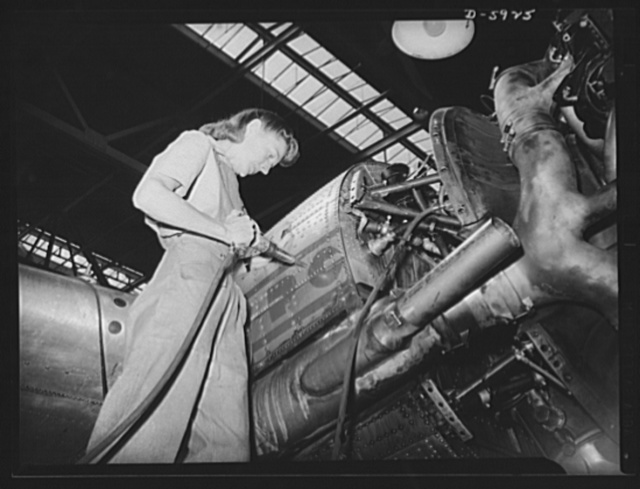 Women airport workers. Acutely aware of our country's need for more womanpower in airplane plants and airports, Mrs. Majorie Landa has enlisted as a member of the repair crew of the Washington National Airport. Daughter of the late Congressman Frank Mandell of Wyoming, Mrs. Landa is shown making repairs on the engine nacelle of a Pennsylvania Central Airlines DC-3 transport plane. Following her second year at Sweetbriar College, she spent two months at a vocational training school in preparation for her present work
