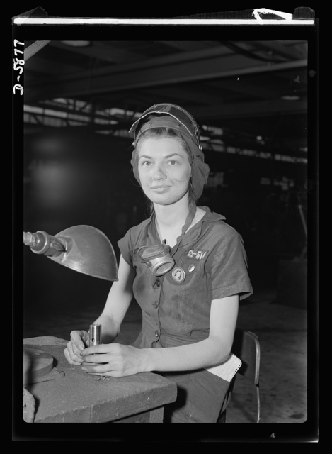 Women in industry. Aircraft motor workers. A million dollar baby, not in terms of money but in her value to Uncle Sam, twenty-one-year-old Eunice Hancock, erstwhile five-and-ten-cent store employee, operates a compressed-air grinder in a Midwest aircraft motor plant. With no previous experience, Eunice quickly mastered the techniques of her war job and today is turning out motor parts with speed and skill. Note protective mask and visor, two vital safety accessories