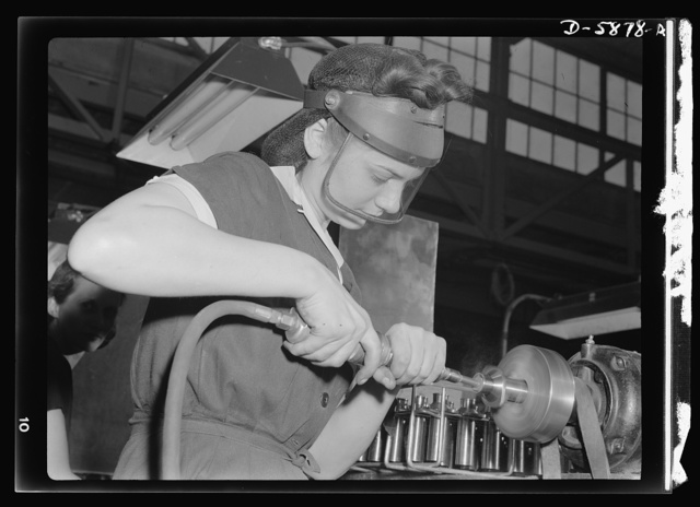 Women in industry. Aircraft motor workers. Employer resistance to the hiring of women workers in war industries is rapidly becoming a thing of the past, and this young employee of a Midwest aircraft motor plant embodies the reasons for this change of heart. With no previous industrial experience, she mastered the operation of this compressed-air machine in record time, and is now polishing airplane motor parts with speed and skill