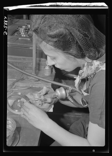 Women in industry. Aircraft motor workers. Using a small rotary air grinder, this young employee of a Midwest aircraft motor plant performs a delicate job on a gear spacer that will see duty in the mechanism of one of America's battleships of the air