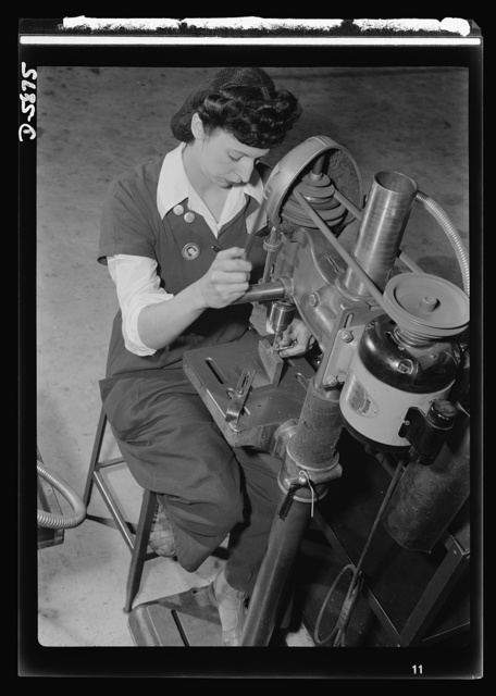 Women in industry. Aircraft motor workers. Youthful Paderewskis, take note! Her finger made superbly flexible by years of piano practice, this young employee of a Midwest aircraft motor plant finds her musical training of great assistance in her war job. The operation of this drill press demands constant, rapid hand and wrist movement--and that's where those hours of do-re-mi are paying dividends. She's countersinking six holes in a bolt, an operation requiring great precision, speed and skill