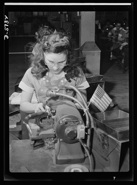 Women in industry. Tool  production. Her mind's on her work and on her country. That small flag tells the story of this young woman's absorption in her job. Employed by a Midwest drill and tool plant, she's grinding points on drills which will be used in the production of America's ships and planes and guns. A soldier of the production front, she fights for the men on America's battlefronts. Republic Drill and Tool Company, Chicago, Illinois