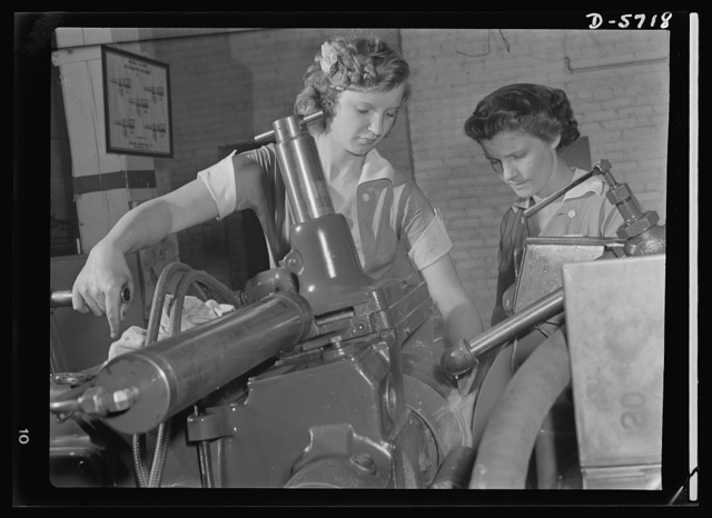 Women in industry. Tool  production. Pioneers of the production line, these two young workers are among the first women ever to operate a centerless grinder, a machine requiring both the knowledge of precision measuring instruments, and considerable experience and skill in setting up. In this Midwest drill and tool plant, manned almost exclusively by women, centerless grinders have been efficiently operated by women for more than a year, and company production figures have continued to soar. Republic Drill and Tool Company, Chicago, Illinois