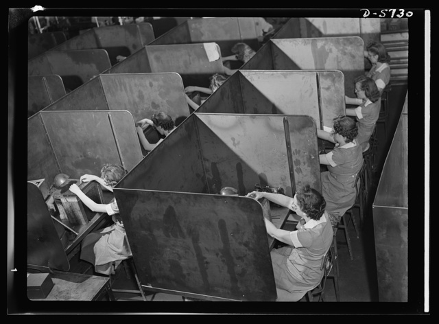 Women in industry. Tool  production. Testing small diameter, high-speed twist drills, these women employed by a Midwest drill and tool company roll the drills down a slight incline to determine regularity of diameter. It's a job requiring patience and finger dexterity, and these young women possess those definite feminine propensities for just such work. Republic Drill and Tool Company, Chicago, Illinois