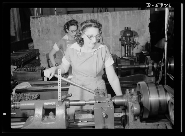 """Women in industry. Tool  production. Two of nearly 1,000 women who """"keep 'em rolling"""" in a large Midwest drill and tool plant, these young workers are skilled lathe operators putting taper shanks on twist drills which are used in all war production. Republic Drill and Tool Company"""