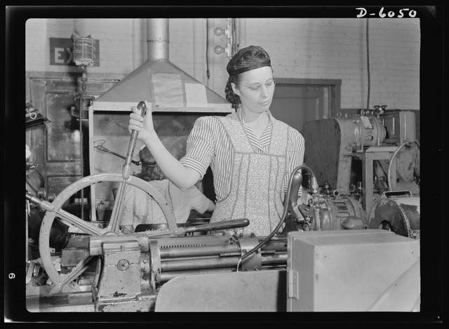 "Women in war. Machine gun production operators. This modern ""spinning wheel"" would astound our grandmothers, and so would the young woman who operates it. One of America's thousands of skilled women war workers, this young Midwesterner twirls the wheel that controls the drilling of holes in machine gun parts. A skilled machine operator, she formerly processed spark plugs on a similar machine, but turned her efforts to war work when the factory was converted to the manufacture of machine guns. A.C. Spark Plugs"