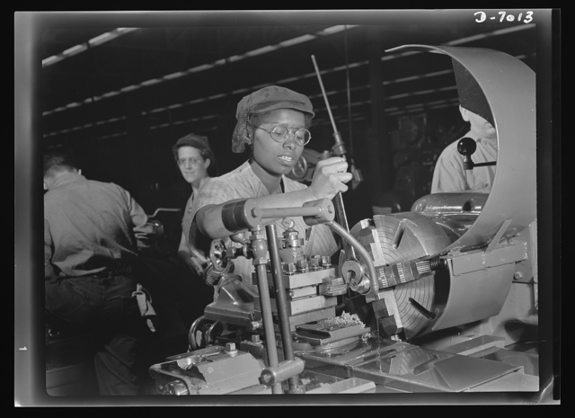 Women in war. Supercharger plant workers. Plant foremen point to 20-year-old Annie Tabor as one of their best lathe operators, despite her lack of previous industrial experience. Employed by a large Midwest supercharger plant, this young woman machines parts of aircraft engines. Like many other young Negro girls, she had known only