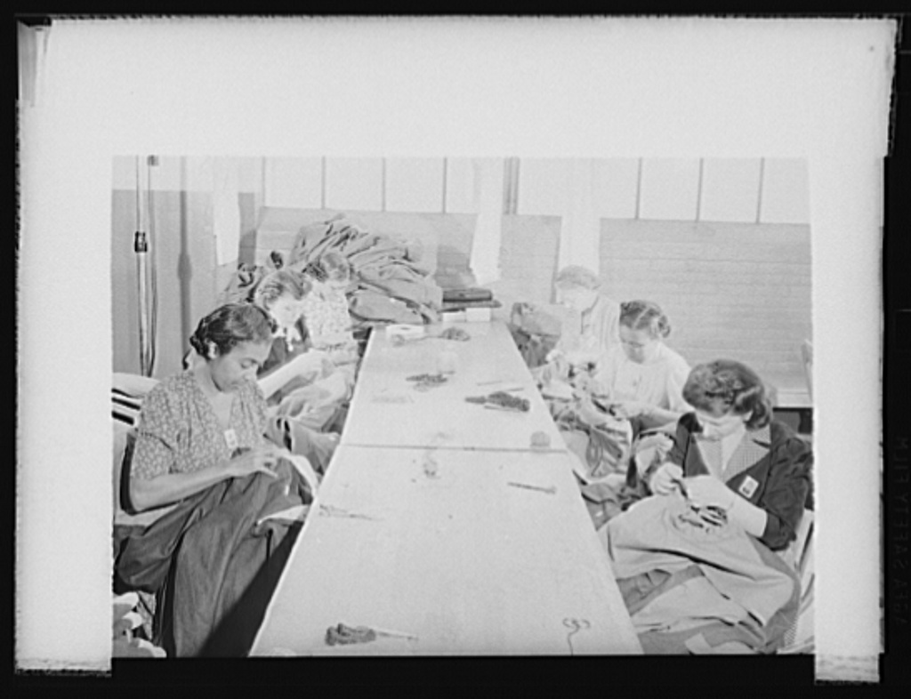 Women workers at quartermaster corps. Women workers of all racial groups are being drawn into war production. These employees of an Eastern quartermaster corps depot are sewing sleeves into army overcoats. Philadelphia Quartermaster Corps