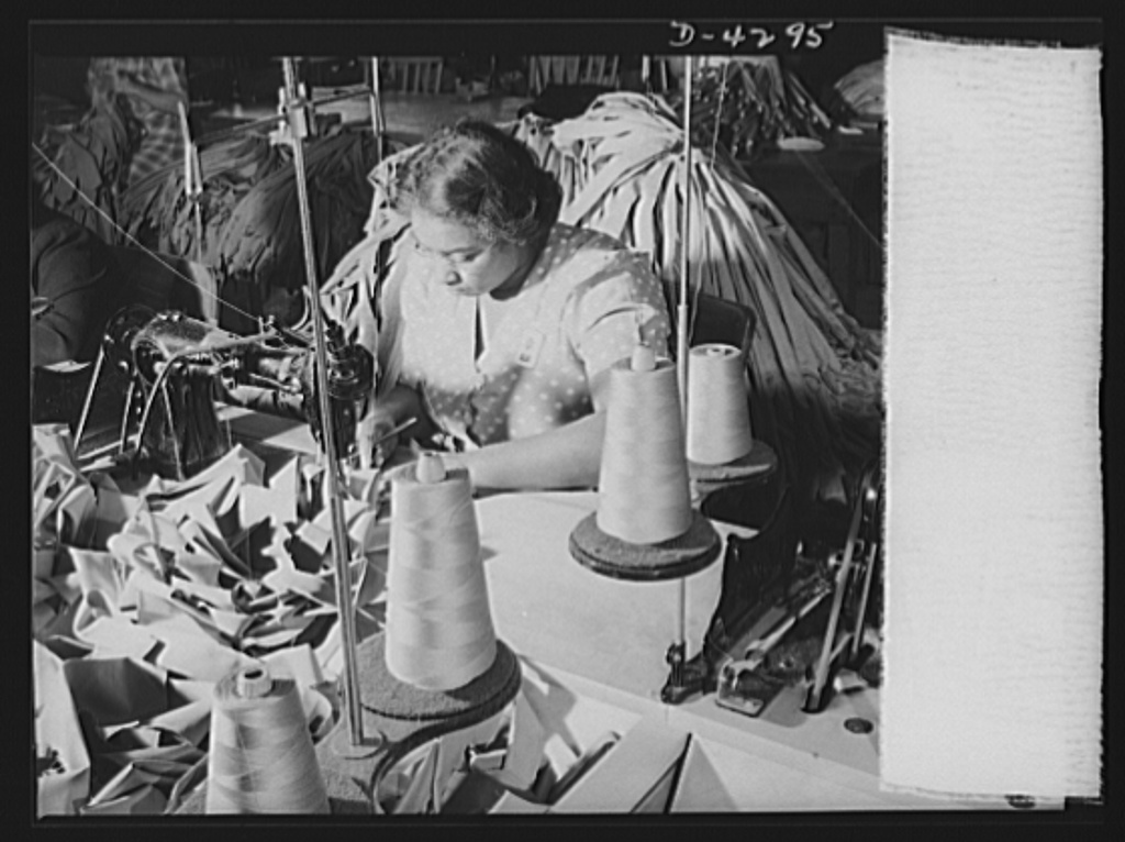 Women workers at quartermaster depot. Clothing for America's expanding army is being made by garment workers throughout the contry. This quartermaster corps depot employee is turning out regulation neckties in mass production quantity. Philadelphia Quartermaster Corps