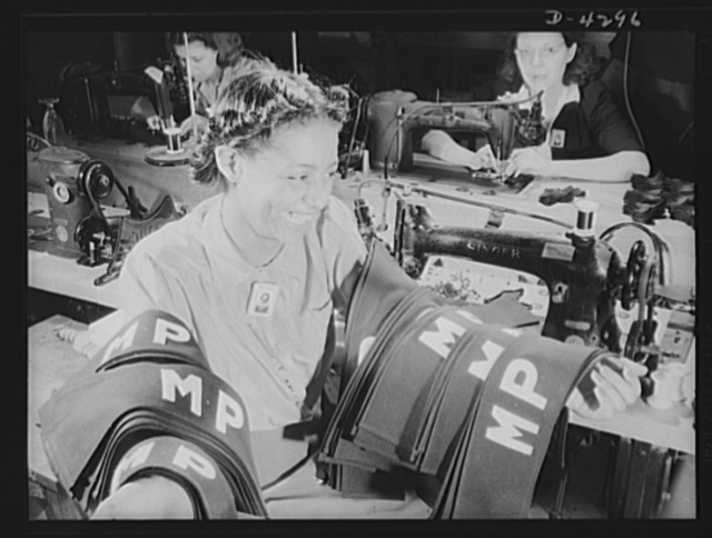 Women workers at quartermaster depot. Insignia for military police are being turned out in an Eastern quartermaster corps depot where this young worker has obtained war production employment. Philadelphia Quartermaster Corps