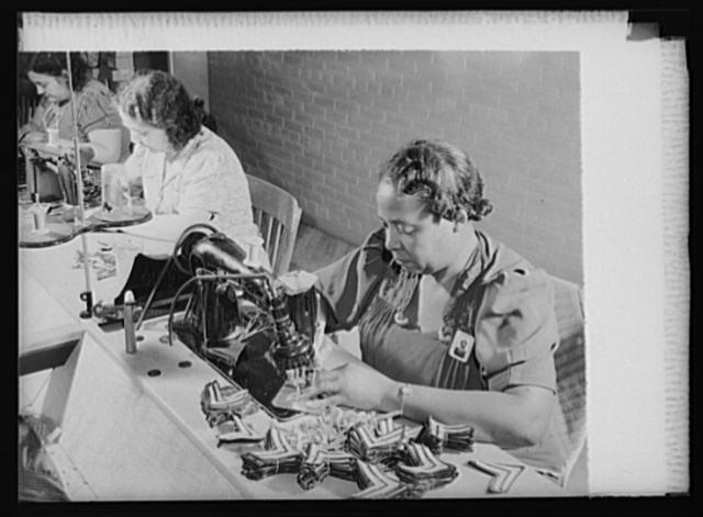 """Women workers at quartermaster depot. """"Making sergeants."""" This woman worker at a quartermaster corps depot is turning out chevrons for promoted enlisted men. Philadelphia Quartermaster Corps"""
