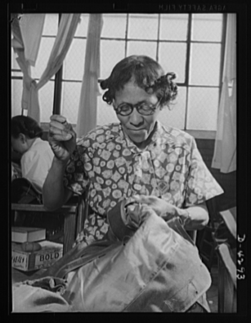 Women workers at quartermaster depot. The nimble fingers of many American women are now contributing to the war effort in various quartermaster corps depots. This elderly woman is handstitching sleeves on an army overcoat. Philadelphia Quartermaster Corps